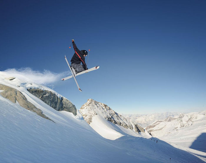 Jumping skier Wall Mural Wallpaper
