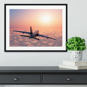 Passenger plane above the clouds Framed Print - Canvas Art Rocks - 1