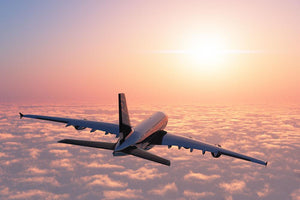 Passenger plane above the clouds Wall Mural Wallpaper - Canvas Art Rocks - 1