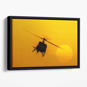 Patrol helicopter flying in sunset Floating Framed Canvas