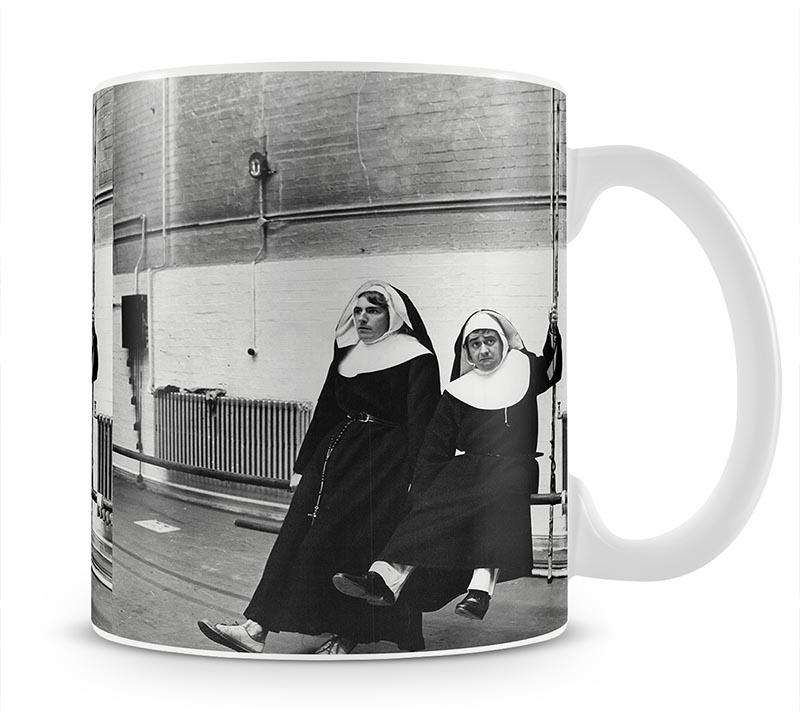 Peter Cook and Dudley Moore dressed as nuns Mug - Canvas Art Rocks - 1