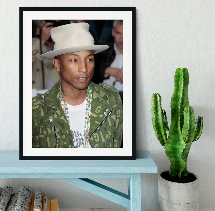 Pharrell Williams in a hat Framed Print