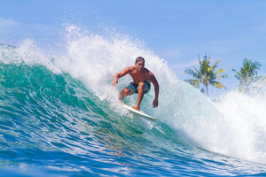 Picture of Surfing a Wave Wall Mural Wallpaper - Canvas Art Rocks - 1