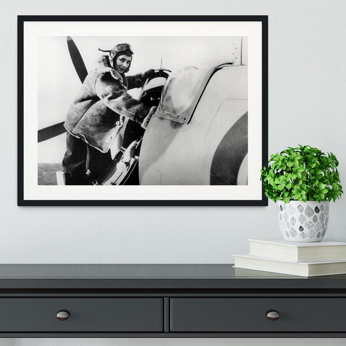 Pilot collecting a Spitfire plane Framed Print