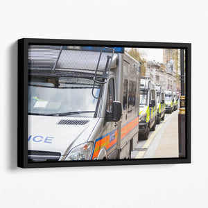 Police vans in a row Floating Framed Canvas