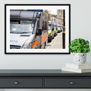 Police vans in a row Framed Print - Canvas Art Rocks - 1