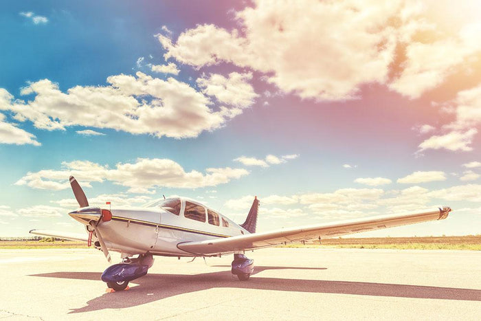 Propeller plane parked Wall Mural Wallpaper