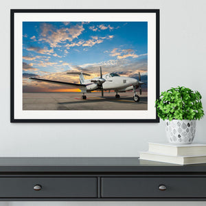 Propeller plane parking at the airport Framed Print - Canvas Art Rocks - 1