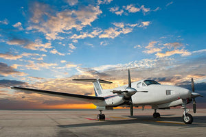 Propeller plane parking at the airport Wall Mural Wallpaper - Canvas Art Rocks - 1