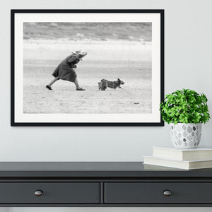 Queen Elizabeth II walking her pet corgis on a Norfolk beach Framed Print - Canvas Art Rocks - 1