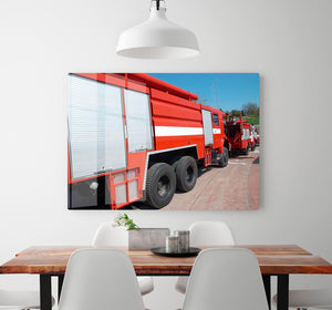 Red fire engine standing on the road HD Metal Print