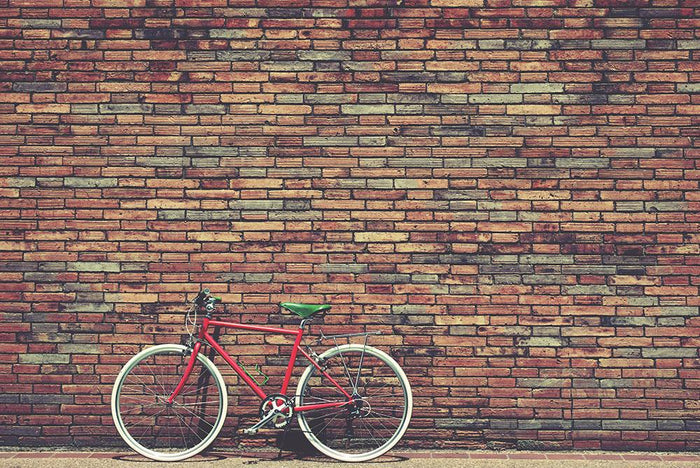 Retro bicycle on roadside Wall Mural Wallpaper