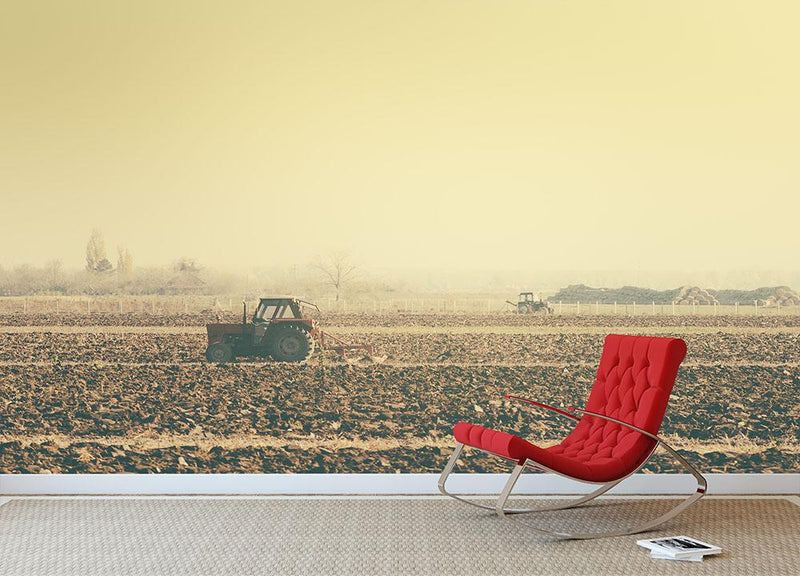 Retro toned tractors on arable field Wall Mural Wallpaper - Canvas Art Rocks - 1