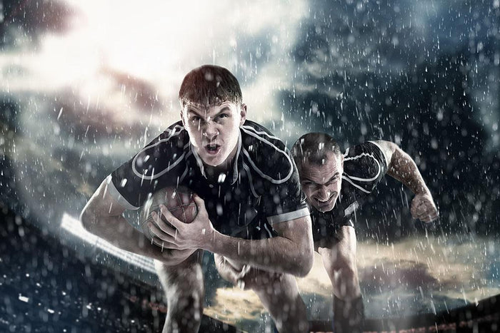 Rugby players running in the rain Wall Mural Wallpaper