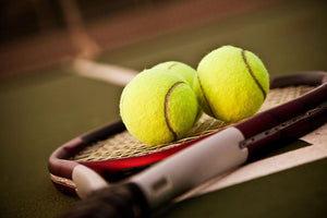 Shot of a tennis racket and tennis balls Wall Mural Wallpaper - Canvas Art Rocks - 1