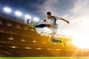 Soccer player in action Wall Mural Wallpaper - Canvas Art Rocks - 1