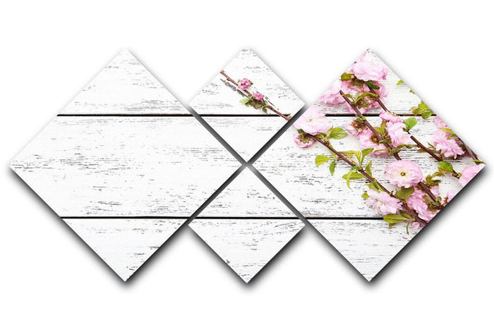 Spring flowering branch on white wooden 4 Square Multi Panel Canvas