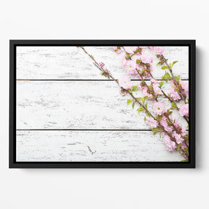 Spring flowering branch on white wooden Floating Framed Canvas