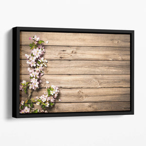 Spring flowering branch on wooden background Floating Framed Canvas