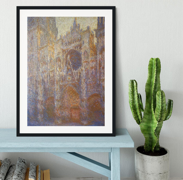 The Rouen Cathedral West facade by Monet Framed Print