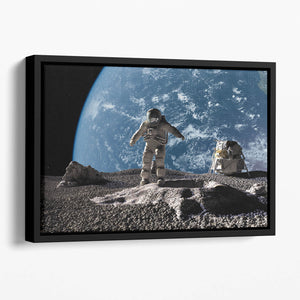 The astronaut on a background of a planet Floating Framed Canvas