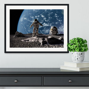 The astronaut on a background of a planet Framed Print - Canvas Art Rocks - 1