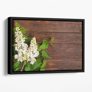 The beautiful lilac on a wooden background Floating Framed Canvas