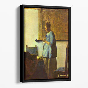 The letter reader by Vermeer Floating Framed Canvas