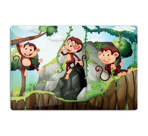 Three monkeys hanging on the branch HD Metal Print