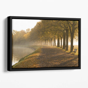 Walkway at the canal in morning Floating Framed Canvas