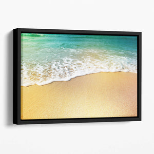 Wave of sea water and sand Floating Framed Canvas