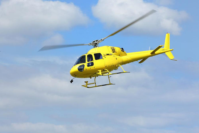 Yellow helicopter in the air Wall Mural Wallpaper