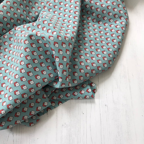 Turquoise Diamond Print Peachskin Fabric