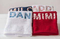 White, red, navy and cream towels
