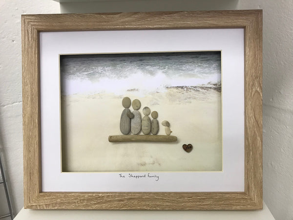 Family 4 and dog on the beach pebble picture in a stand up frame
