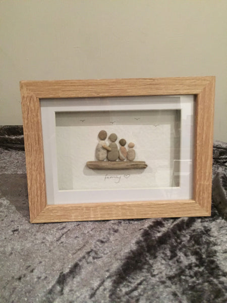 Family 4 pebble picture in a stand up frame