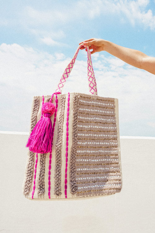 pink, silver, and gold beach bag