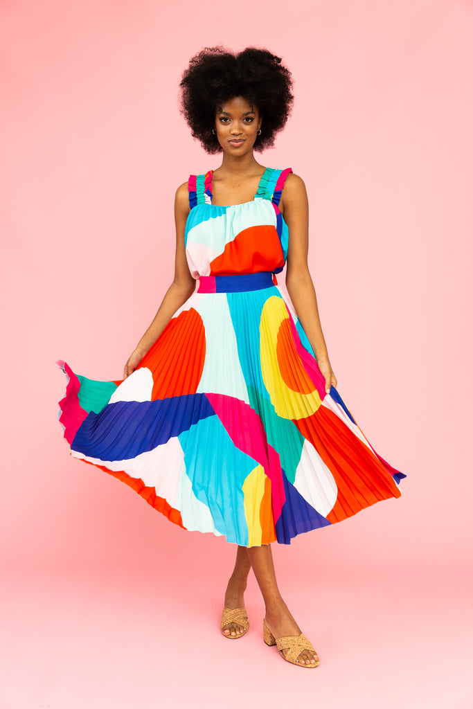 Brightly colored pleated skirt with matching tank top