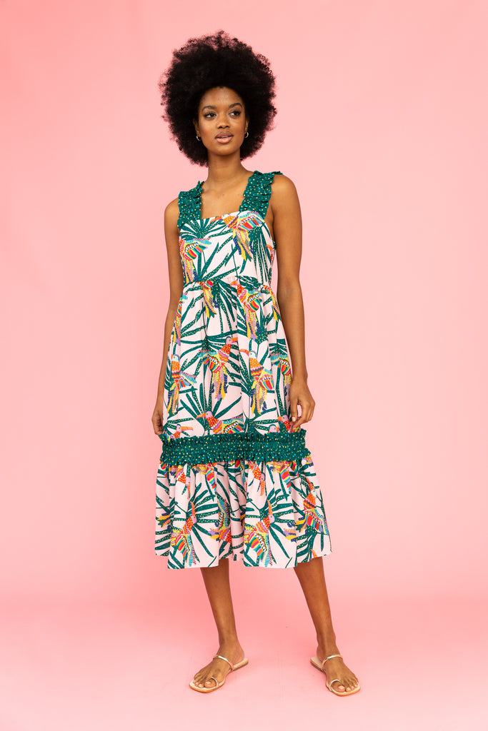 Sleeveless dress with parrot and leaf pattern