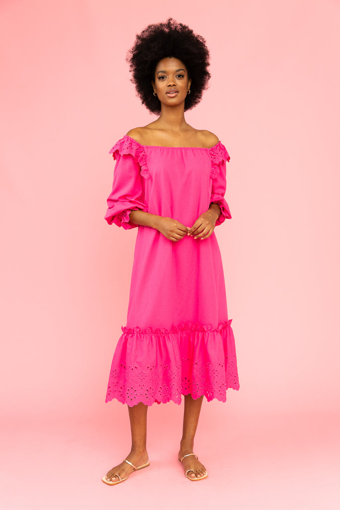 Vivid pink maxi dress with eyelet details and ruffles at the neckline