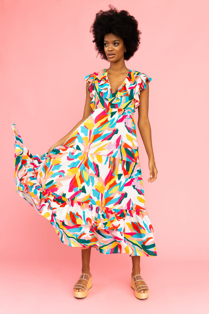 Brightly colored tiered maxi dress with flutter sleeves and ruffled v-neck detail