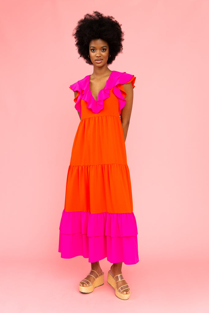 Brightly colored red and pink maxi dress with flutter sleeves and ruffled v-neckline