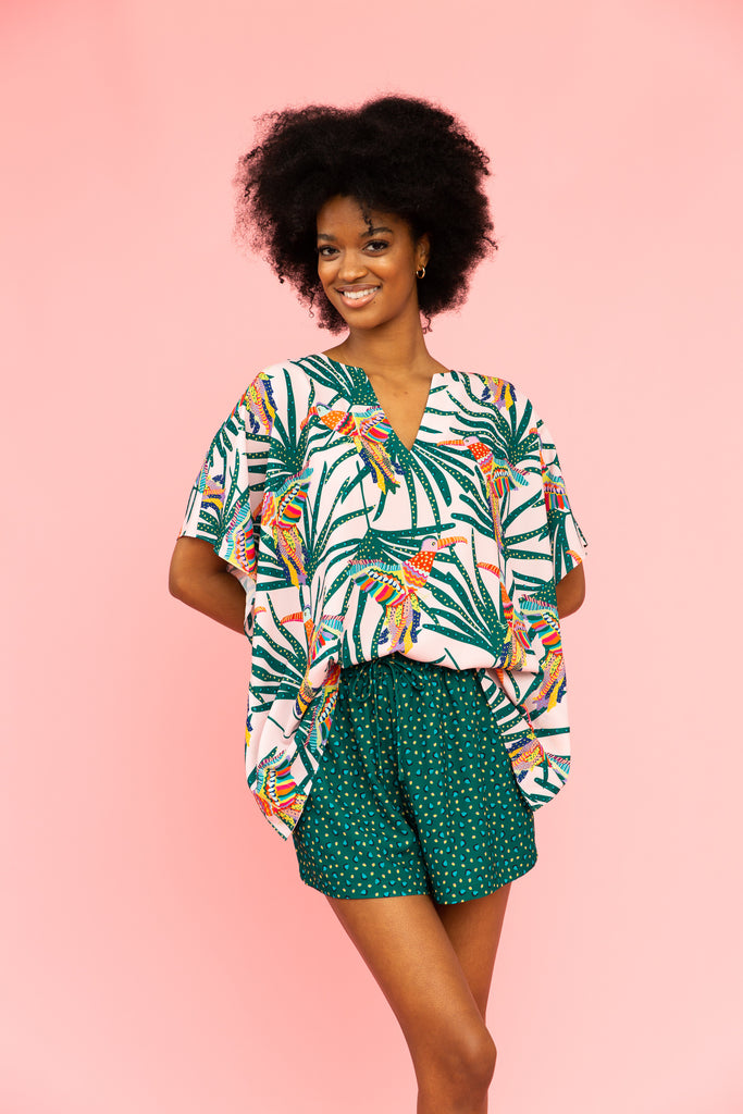 Patterned v-neck tunic top with parrots and leaves with green patterned shorts