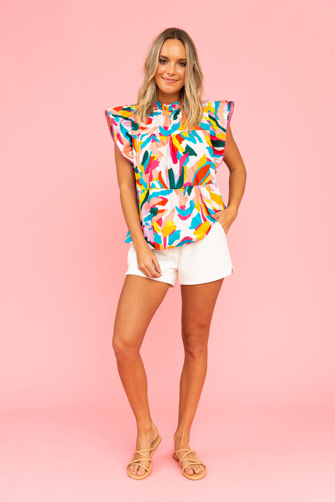 Brightly colored tiered top with white shorts