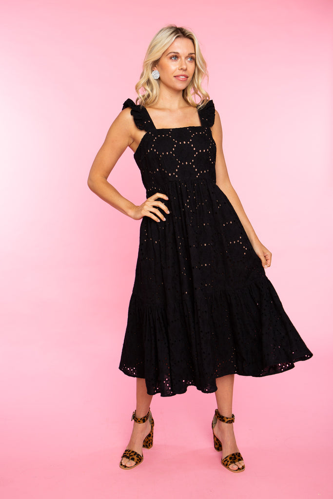 woman wearing black eyelet cotton sundress