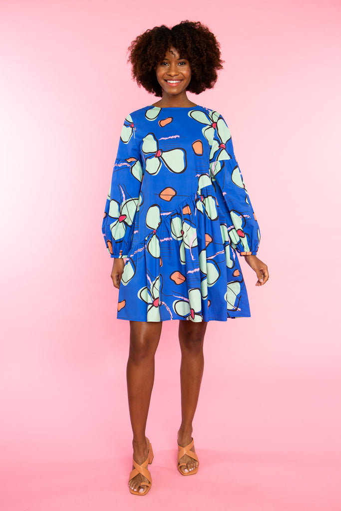 woman wearing orchid print cotton dress with long sleeve