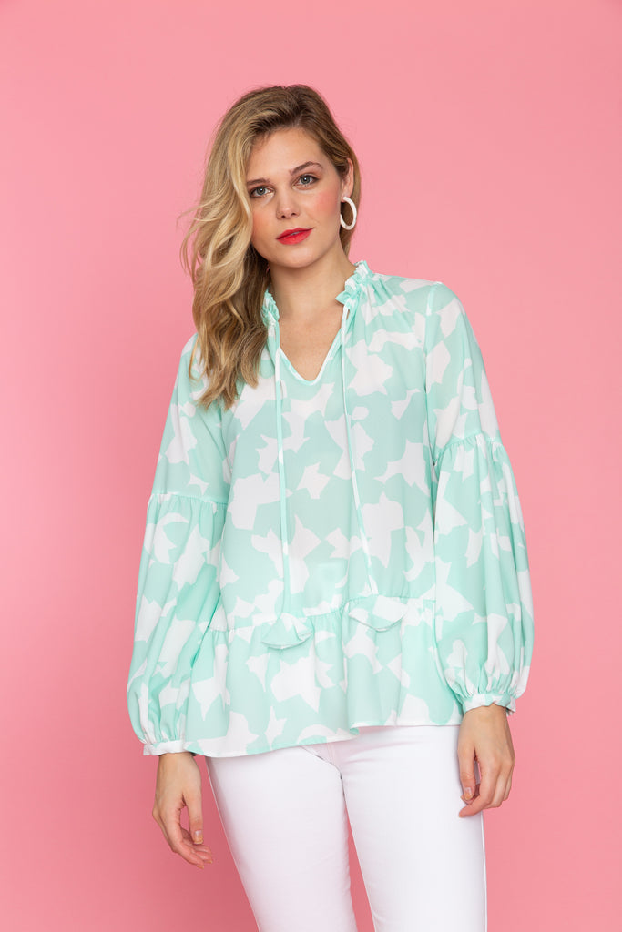 Woman in mint floral long sleeve tunic
