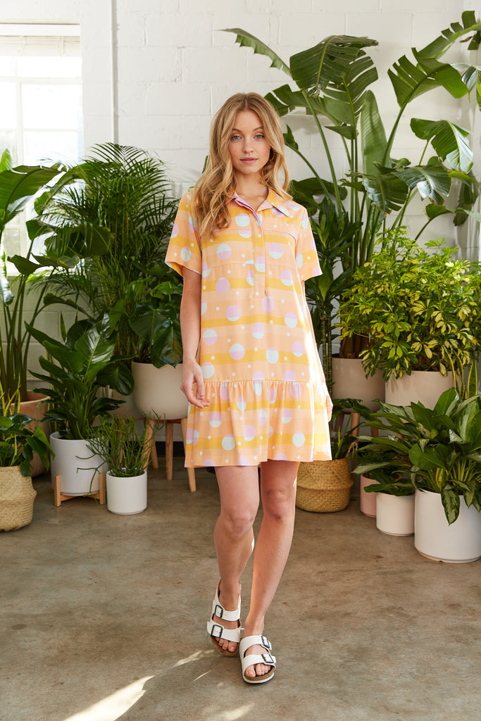 Orange printed above-the-knee shirtdress with flounce