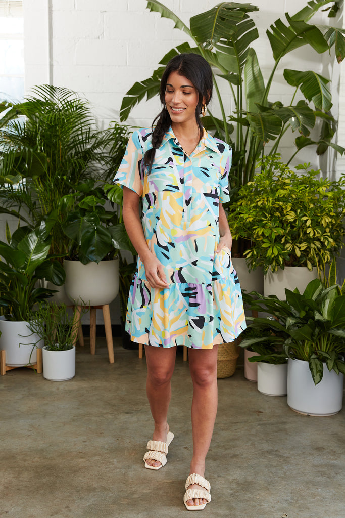 Bright tropical printed shirtdress with flounce