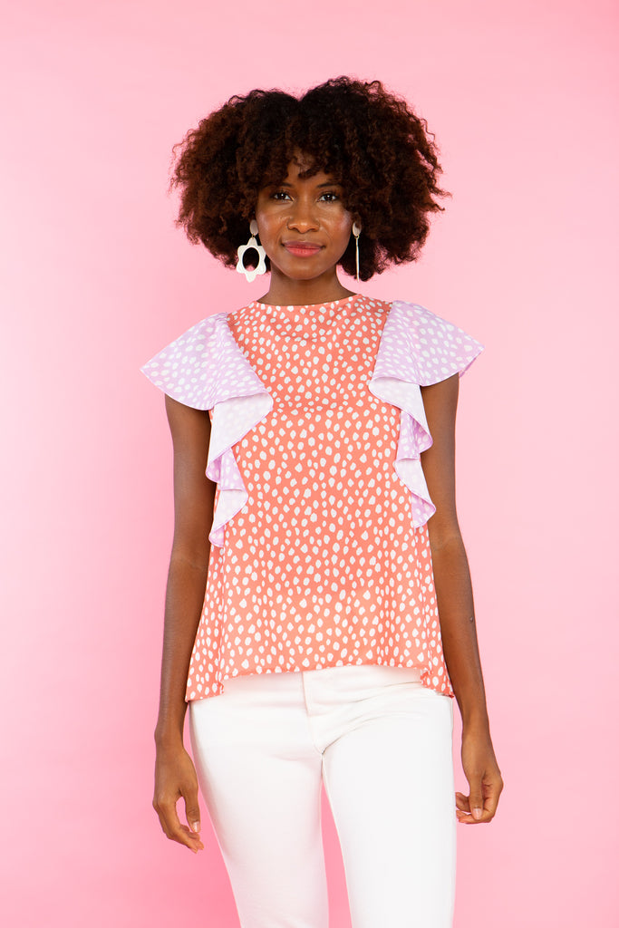 black woman wearing peach and lilac print mix tank